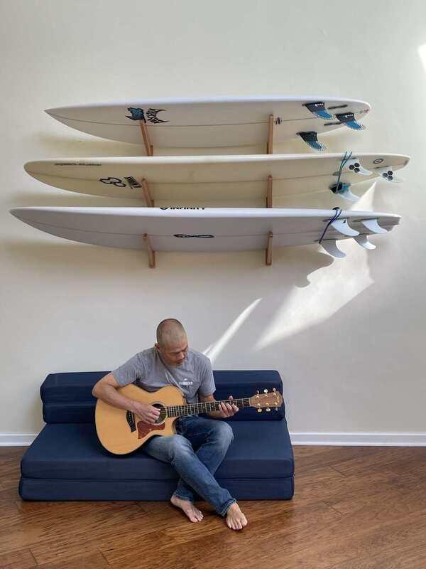 Playing acoustic guitar his music studio in Los Angeles - Jon Lee